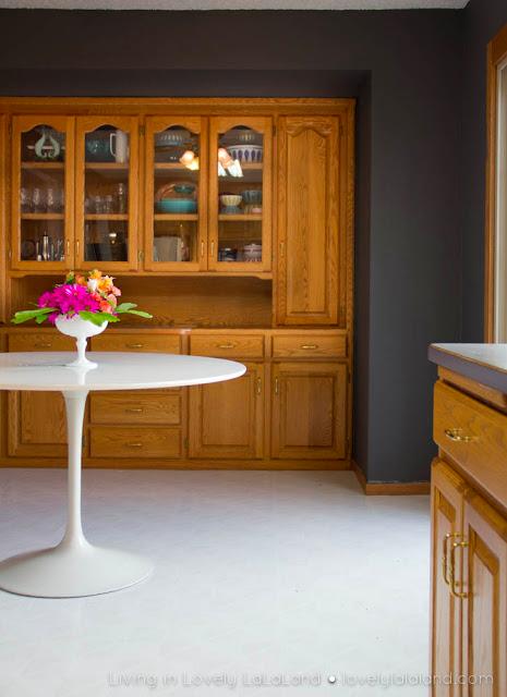 Oak cabinets with slate gray walls