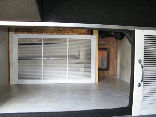 Cat door leading to RV garage area - litter box storage idea for campers or motorhomes