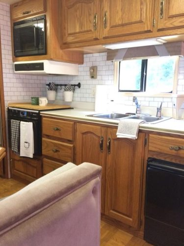 Peel and tick subway tile backsplash in a motorhome