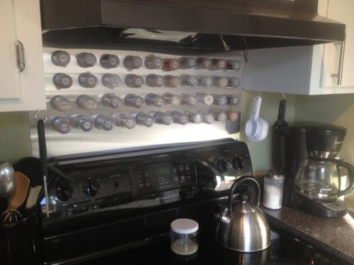 Stainless steel backsplash for magnetic spice containers