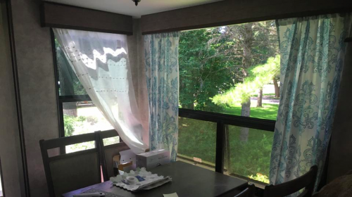 RV window treatment makeover idea: Curtains hung with tension rod