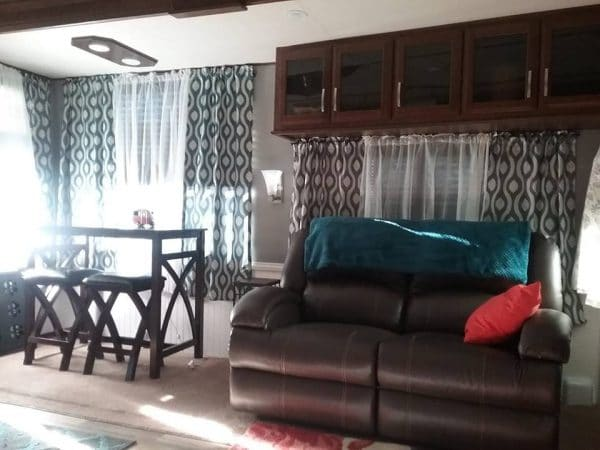 Traditional floor to ceiling curtains in a fifth wheel RV