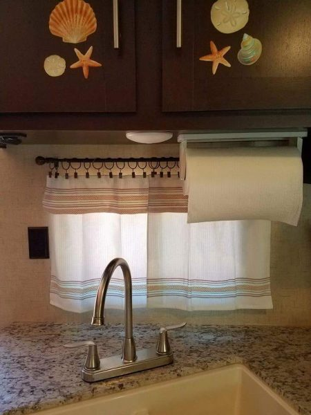 Dish towels used as RV kitchen curtains