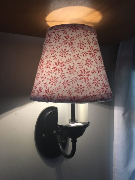 The finished lampshade on the wall