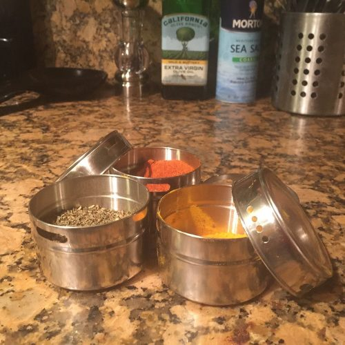 Magnetic spice tins with metal spice rack