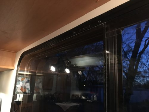 DIY RV storm windows made out of plexiglass to insulate windows for cold weather in winter