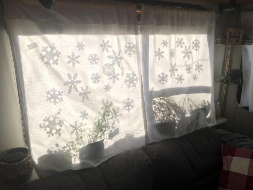 Silhouette of snowflakes on my RV window curtains