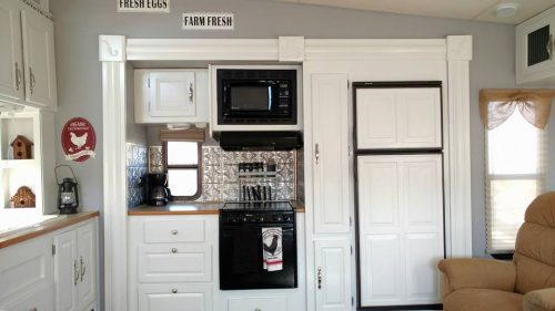 Bright and cheerful Farmhouse style RV kitchen makeover by Michelle Sharp