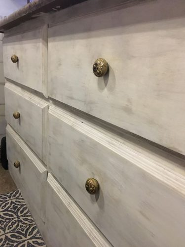 Antiqued painted wood dresser in a fifth wheel RV by Christina LaPlaca