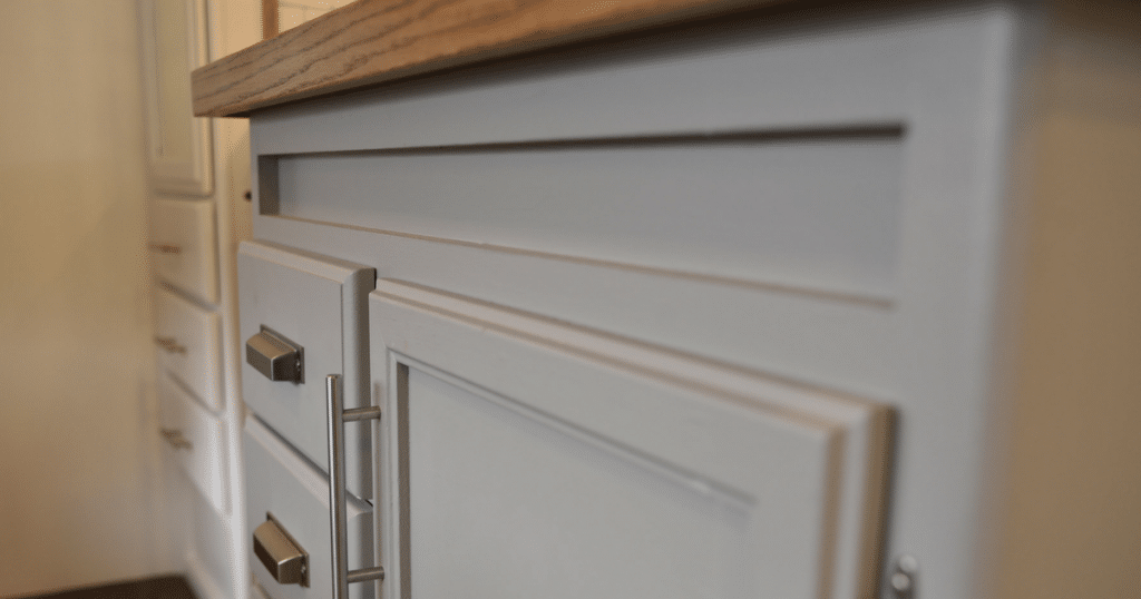 Cabinets painted gray in an RV kitchen