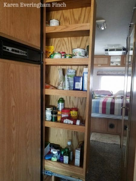 This DIY slide out shelf makes it easer to reach things in the back of a narrow, deep kitchen pantry cabinet. #RV #motorhome #traveltrailer #camper