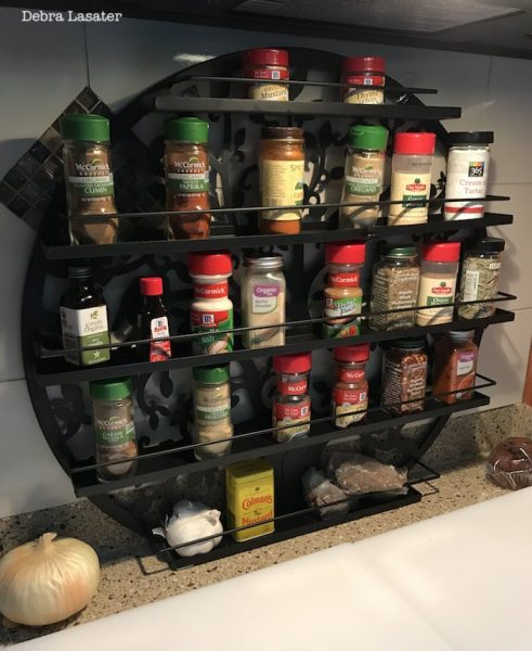 Nail polish rack used as spice storage shelf in an RV kitchen