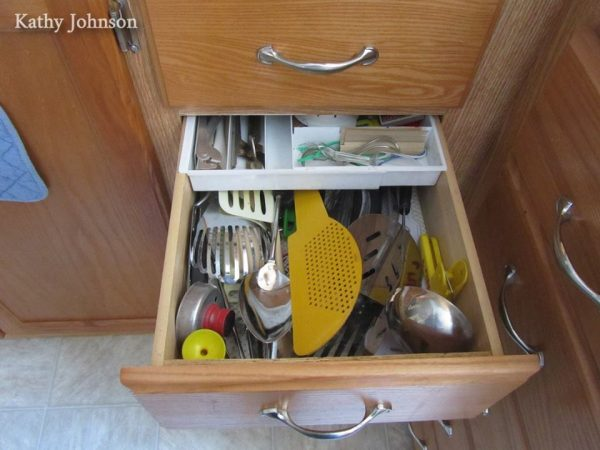 A drawer organizer adds extra storage in an RV kitchen