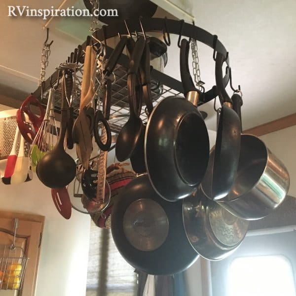 Pot rack hung from vent in RV kitchen