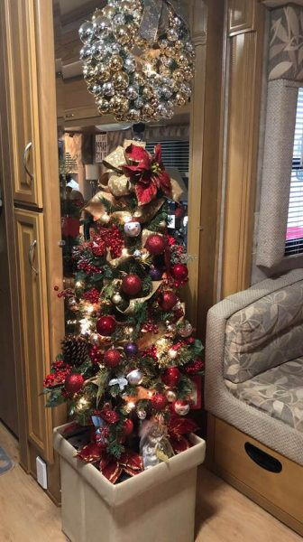 Christmas tree in RV with storage ottoman as base by Gaylene Charles-Getman