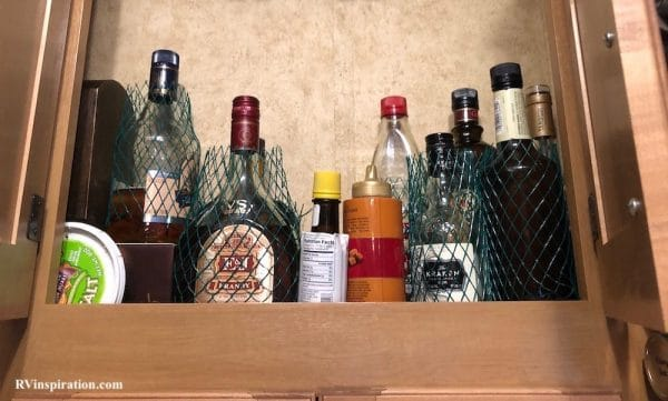 Mesh liquor sleeves for protecting glass bottles in RV kitchen