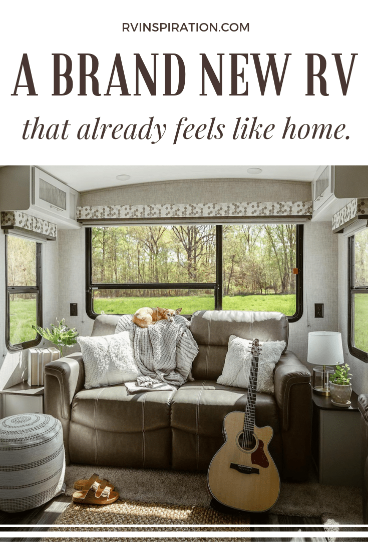 Click to see more photos of the gray and white interior of the Keystone Bullet Premier! #RV #RVlife #Camper #TravelTrailer