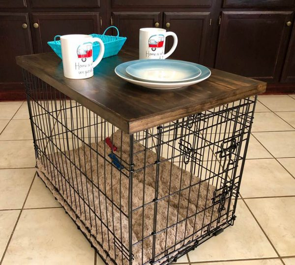 Dog pen with wood top added to create a side table