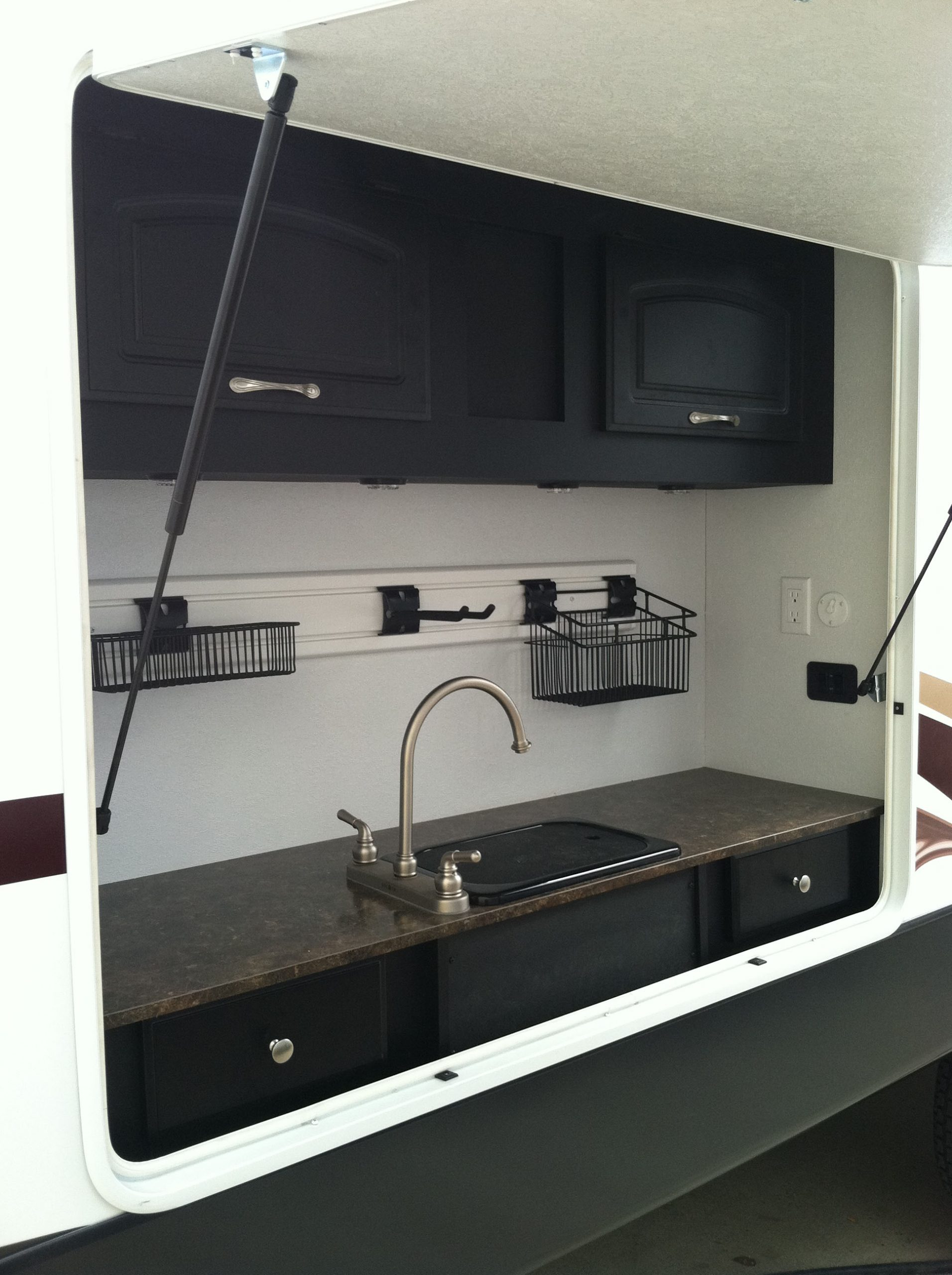 Slatwall organization system for outdoor RV kitchen