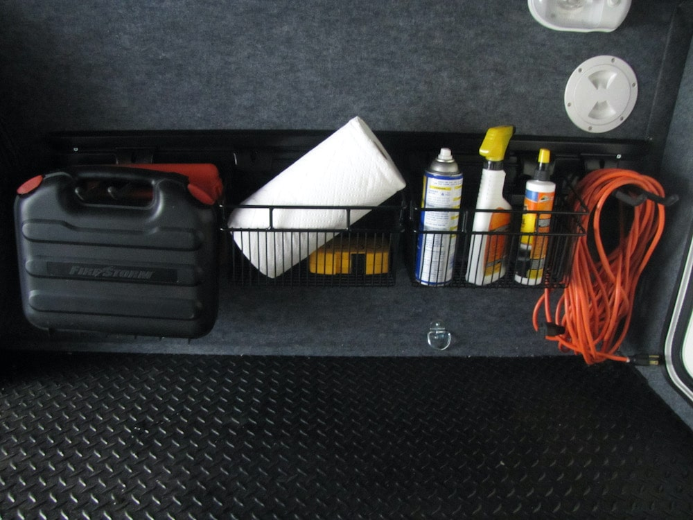 Slatwall organization system from OrganizedObie.com for organizing storage area under RV
