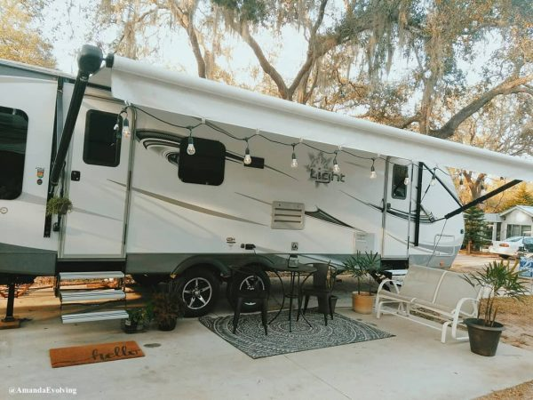 RV patio ideas - string lights, rug, and plants
