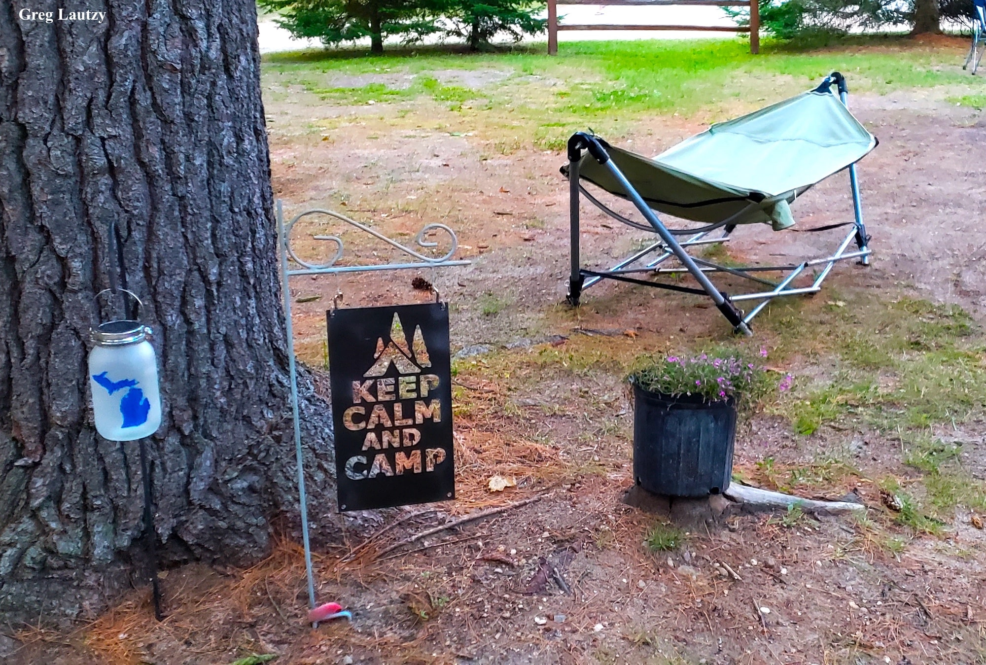 Campsite decor - yard sign, lantern, and hammock
