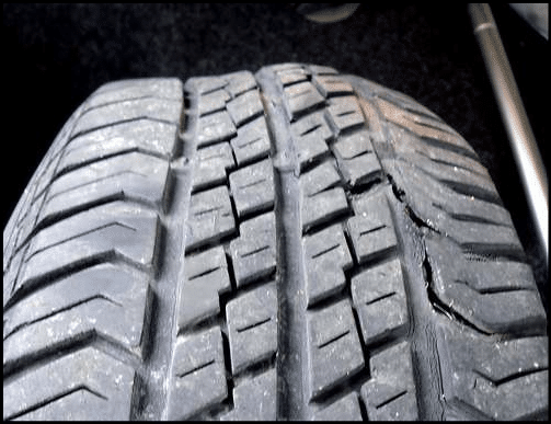 Preventing RV tire blowouts - tire showing bulges and cracks